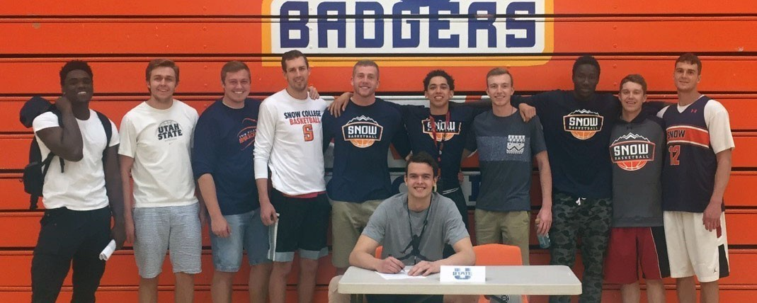 Norber Janicek signs a NLI to play basketball at Utah State